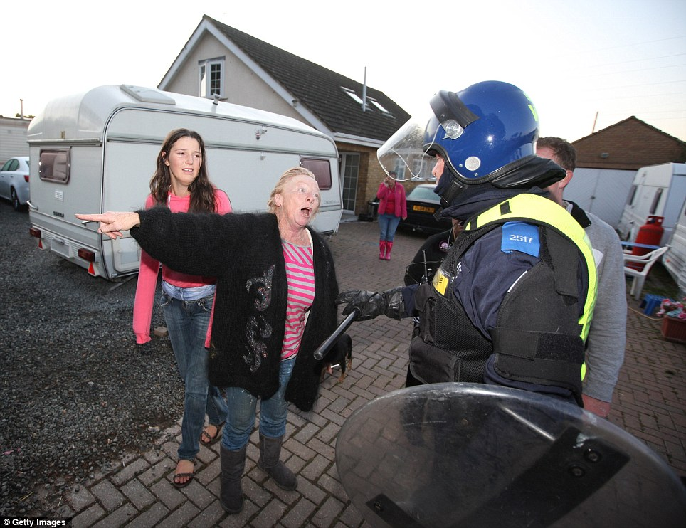 Argument: Traveller Maime Slattery remonstrates with police over one of several legal plots on Dale Farm