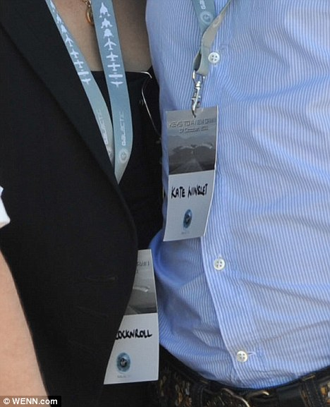 How sweet: The loved up couple swapped their ID tags during the unveiling of a new runway at the Spaceport