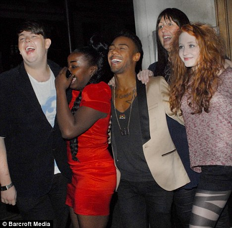 Living the high life: The group can't believe their luck as they pose outside Hard Rock Cafe in central London