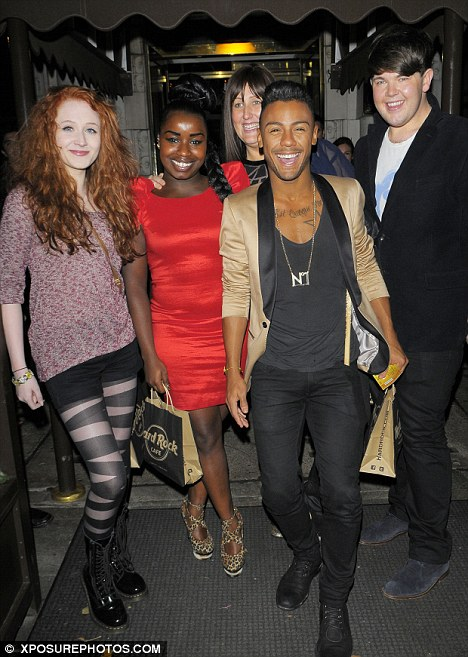 Night off: Janet Devlin, Misha B, Criag Colton, Marcus Collins and Sami Brooks (behind) head to the Hard Rock Cafe ahead of this weekends show