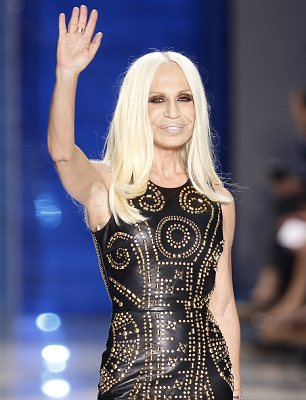 Showing off the collection: Donatella Versace in the studded dress which will go on sale at H&M