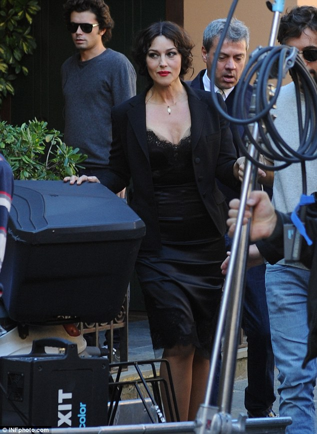 Woman in black: Monica teases with her delicate, but low-cut dress