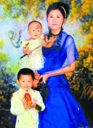 Loved ones: Yue Yue pictured being held by her mother with her older brother in the foreground