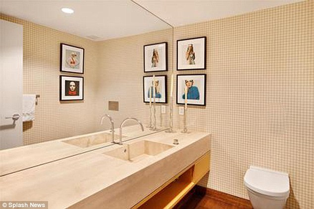 The white stuff: The bathroom is decorated in cream tile with a wooden floor