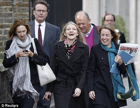 Happy: Katia Zatuliveter, centre, walks with lawyers to her immigration hearing in London last week