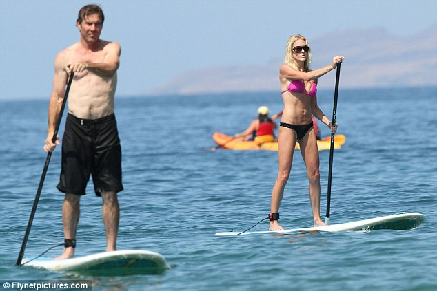 What a fit pair! Dennis Quaid and his wife Kimberly showed off her toned figures as they hit the surf in Hawaii