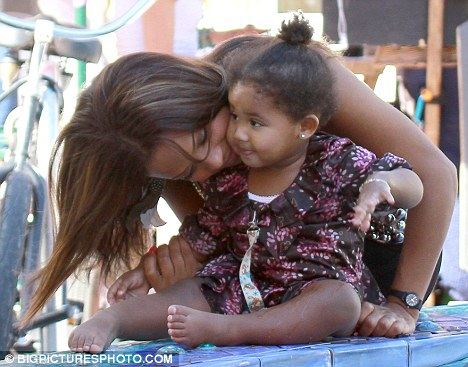 Adorable: With Violet looking so cute in a frilly dress, it's little wonder Christina couldn't stop hugging and kissing her