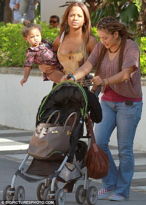Heading home: Christina used the buggy to carry her handbag, instead preferring to carry Violet herself