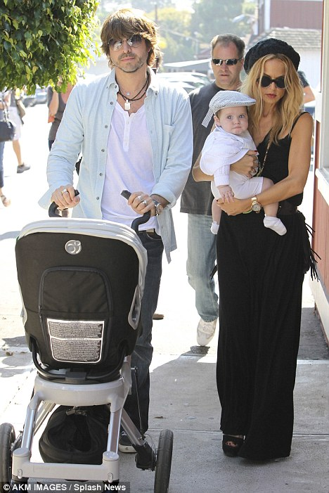 Family affair: Mother and son duo were joined by Rachel's husband and Skylar's father Rodger Berman as they enjoyed their day out