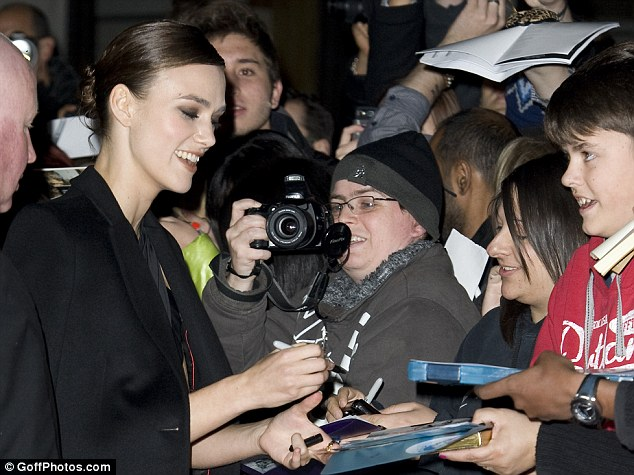 We love you! Keira borrowed a friend's jacket as she went round signing autographs for fans