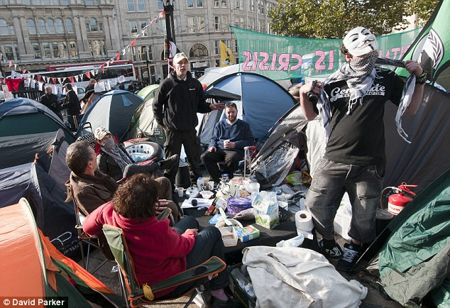 Sham? The protests at St Paul's have been accused of being a 'big charade' with only one in ten tents occupied overnight, suggesting that the majority of the 300 'defiant' protesters return home after dark to sleep in warm beds