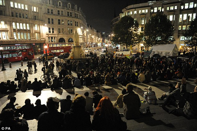 Row: Occupy London protesters outside St Paul's Cathedral. Their demonstrations have forced the closure of the iconic landmark