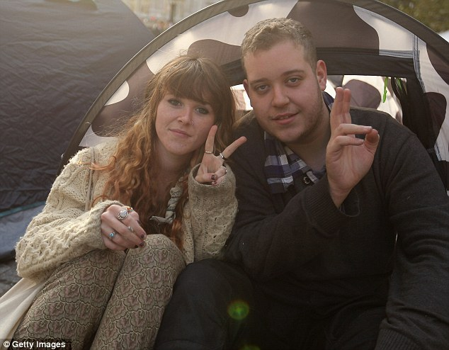 V for victory: Zak Smith, 18, unemployed, with friend Jordan Claire, also 18. They have both been there since the start