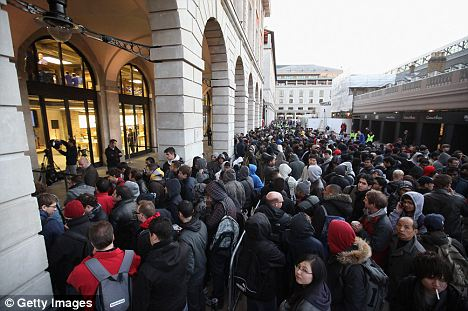 Cult item: Customers queue outside the Apple store in Covent Garden to be among the first to buy an iPhone 4S earlier this month