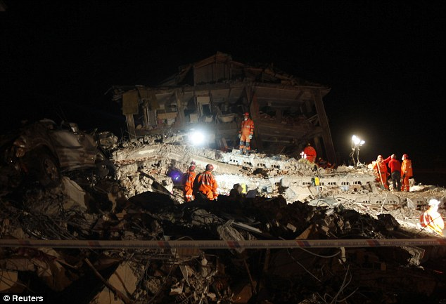Race against time: Rescue workers battle to find survivors under the debris in Ercis, Turkey, after a powerful earthquake on Sunday. A 27-year-old woman was pulled out alive 67 hours after the quake this morning