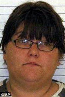 Mother: Ashly Clark kept her two sons locked in a wire dog cage at their mobile home in Nebraska