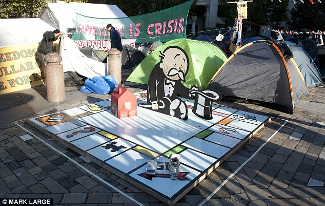 It is believed that street artist Banksy is behind the Monopoly art installation at the Occupy London movement's camp