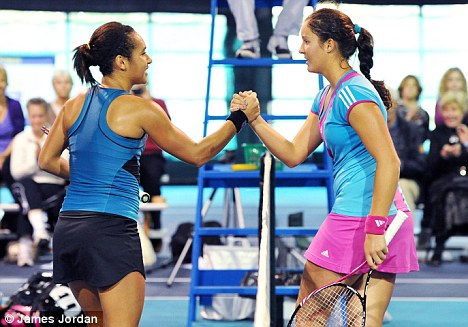 Down and out: Laura Robson (R), who beat Heather Watson on Wednesday, was beaten in Barnstaple by Russian Ekaterina Bychkova