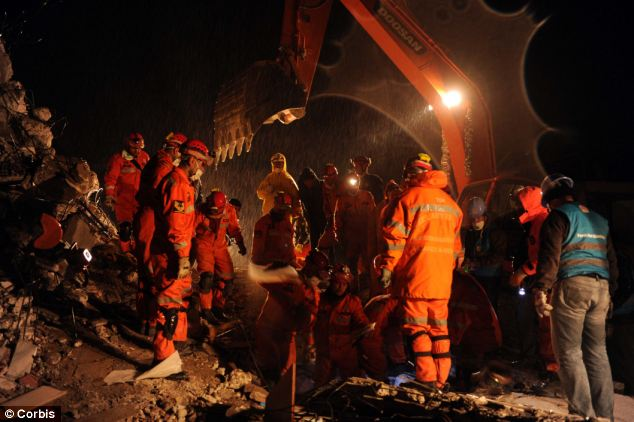 Hopes fading: Heavy rain and snow have hampered rescue operations in Ercis, and many crews have given up searching for survivors in the rubble