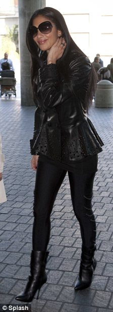 Hell for leather: At the airport today Nicole stepped out in tight leggings and a black leather jacket as she headed to LAX