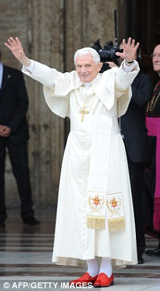 Pope Benedict, seen here waving as he arrives at Santa Maria degli Angeli's basilica, described violence in the name of God as 'an abuse of the Christian faith'