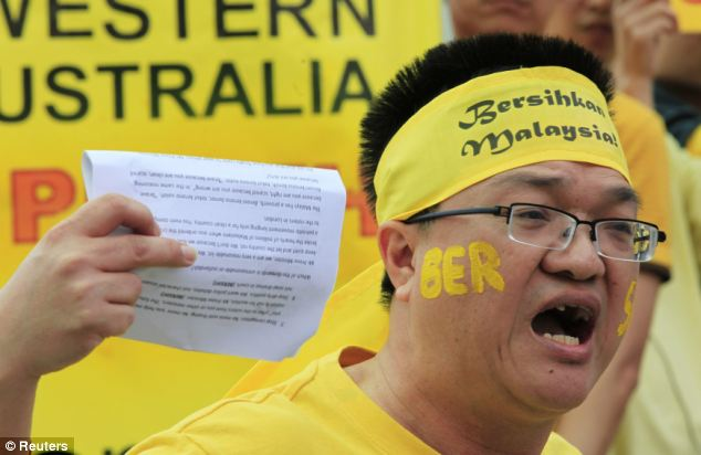 A man shouts slogans demanding electoral reforms in Malaysia during a protest near the venue of the Commonwealth Heads of Government Meeting in Perth this morning