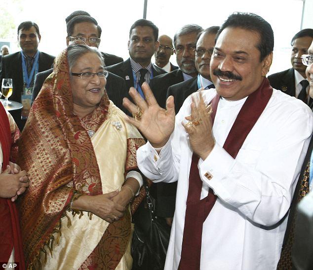 Bangladeshi Prime Minister Sheikh Hasina, left, listens to Sri Lanka's President Mahinda Rajapaksa during the Commonwealth Heads of Government Meeting today