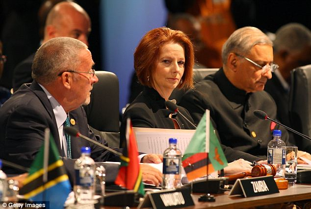 Australian prime minister Julia Gillard and secretary-general Kamalesh Sharma look on during the Executive Session 1 meeting at the Commonwealth Heads of Government Meeting