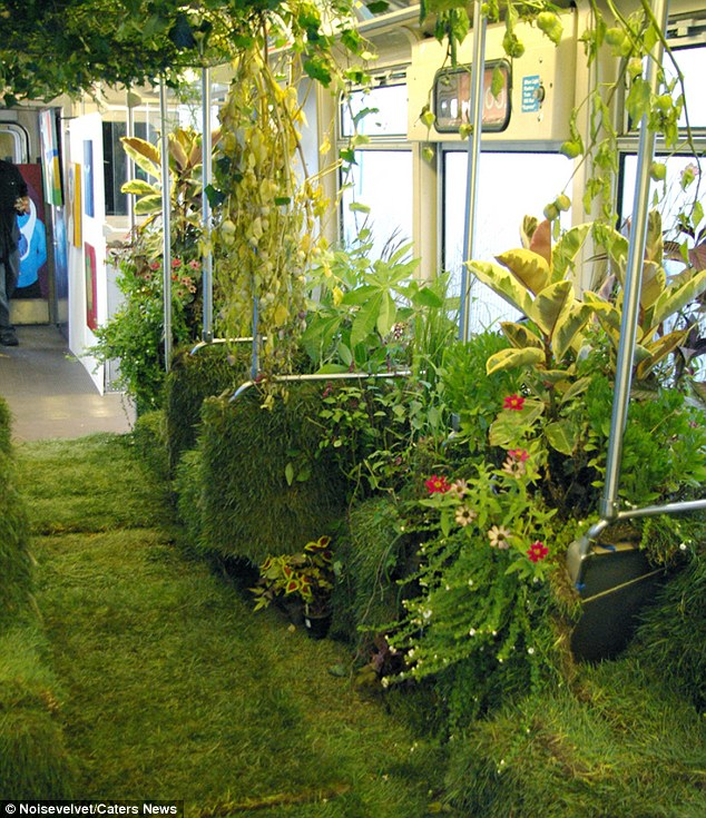 Inspired by nature: Every inch of floor and seat space was covered in lush green plants and grass