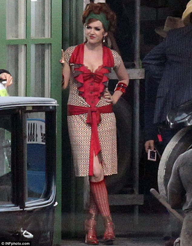Her stock is rising: Isla Fisher donned a racy pair of red knee high stockings on the location set of The Great Gatsby in Sydney, Australia