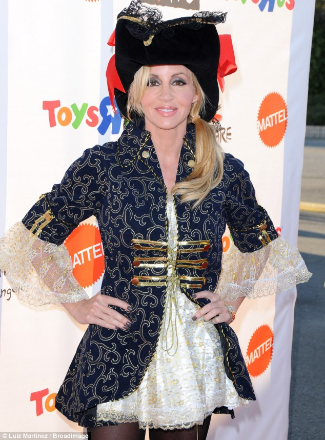 Buccaneer: Camille donned a lacey dress with an embroidered jacket and matching gold-rimmed hat for the occasion