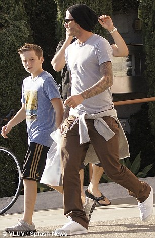 Guy time: While Victoria has been ensuring that Harper's fashion sense develops as befitting a Beckham girl, Brooklyn appeared to be imitating his father's hairstyle this week in Los Angeles