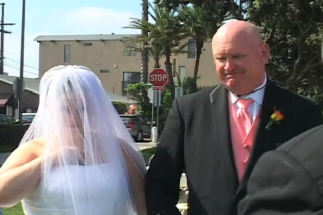 Daddy's girl: Having walked his daughter down the aisle, the father looked a little embarrassed when she blatantly ignored what the preacher was saying