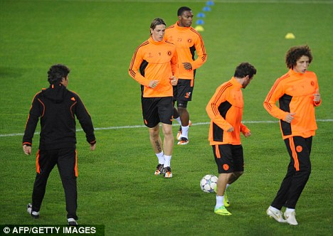 In training: Chelsea warm up ahead of their Champions League clash at Genk