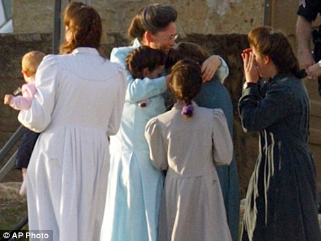 Rescued: A group of women church members tearfully embrace after being reunited at Fort Concho, Texas, after the raid on the church