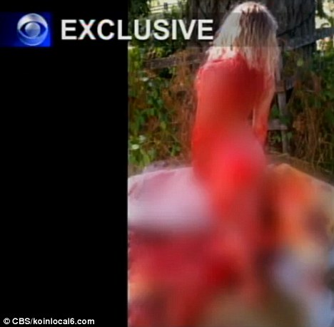 Not criminal: Police say the photos, including this one of the woman - standing on front of the animal covered in its blood - are not enough to press charges
