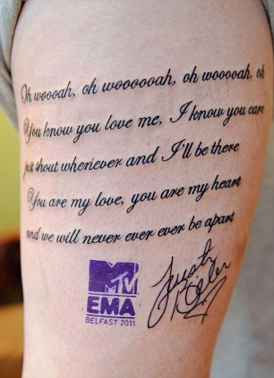The girl hoped that her tattoo would prove her dedication to music, thus landing her VIP tickets offered by MTV to the most devoted fan