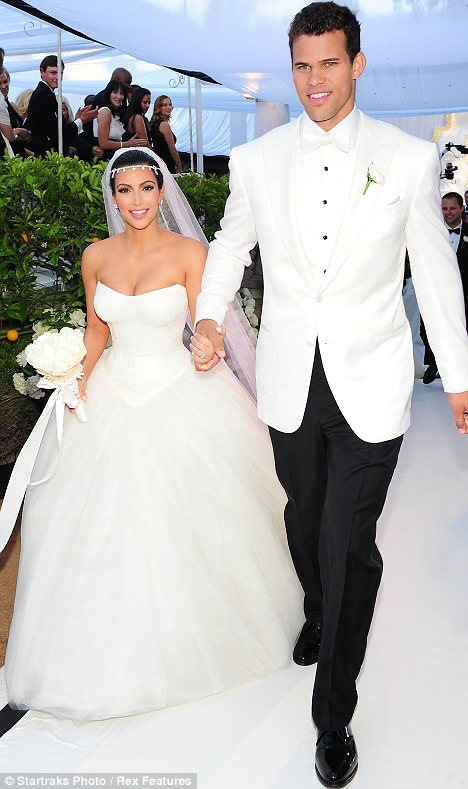 Bad omen: A failed marriage is hardly the best way to advertise wedding dresses - with some fearing replica Kim gowns may be cursed