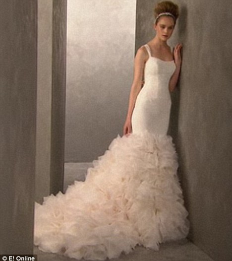Imitation: Two Vera Wang copies of Kim's dress are due to go one sale at David's Bridal in February
