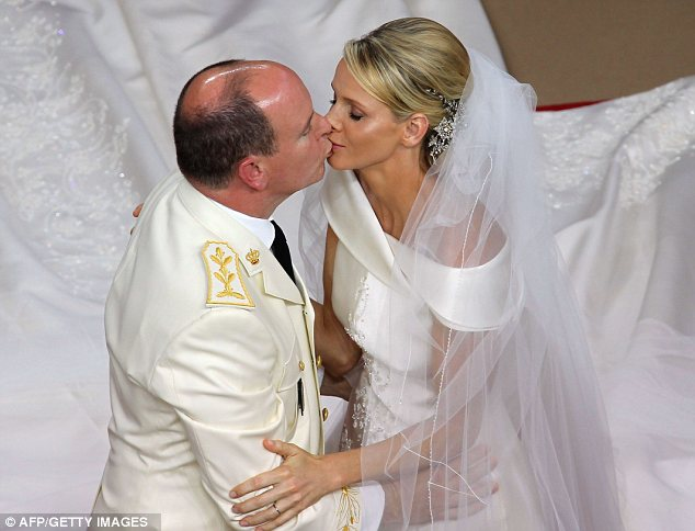 Prince Albert II of Monaco kisses Princess Charlene of Monaco during their religious wedding at the Main Courtyard of the Prince's Palace on July 2, 2011 in Monaco
