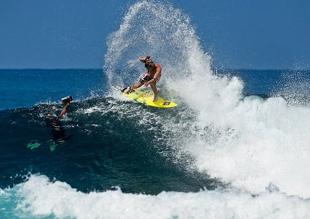 Riding a wave: Pro-surfer Jamie O'Brien, who lives in Hawaii, being captured in action