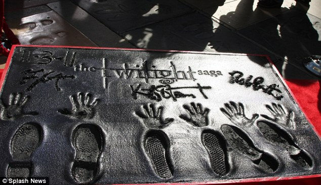Finished article: The trio had their hands and feet printed into the cement and they also wrote their names