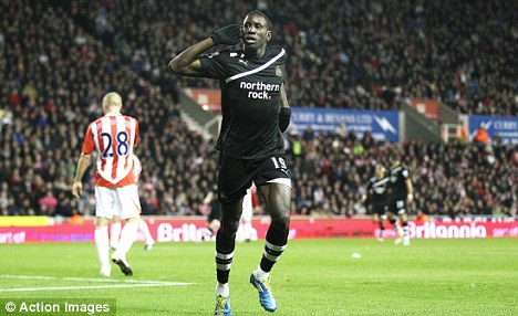 Strike one: Ba celebrates the first goal of his hat-trick against Stoke on Monday action