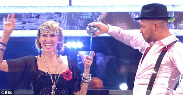 Cheers! The pair ended their dance by pouring a Martini for the former Queen Vic landlady