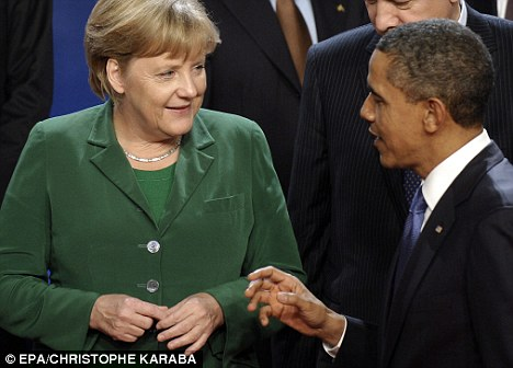 Promise: Mrs Merkel, seen here speaking to Barack Obama at the G20 summit in Cannes, had made tax cuts an election promise of her government