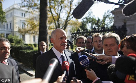 Embattled: The eurozone crisis has seen Greece's Prime Minister George Papandreou on the brink of resigning, according to his own party