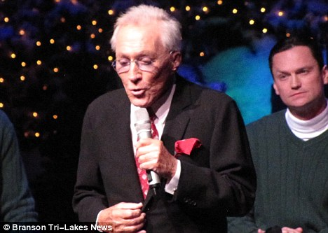 Onstage: Williams announced he was suffering from bladder cancer at a Christmas concert in Branson, Missouri, last year (pictured)