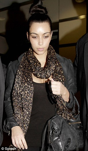 Showing the strain: The star leaving LAX airport after an exhausting visit with her ex