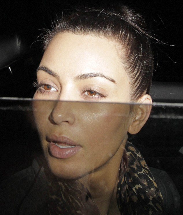 Unmasked: Kim Kardashian looked tired and drained as she arrived back in LA following a meeting with her estranged husband Kris Humphries