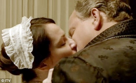 Scandal: Fans of the show watched with baited breath as Lord Grantham passionately kissed his maid inside his bedroom